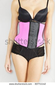 stock-photo-young-woman-wearing-a-waist-training-corset-in-black-underwear-which-is-the-new-craze-for-looking-307711142